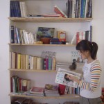 student reading a book from the inflexyon library